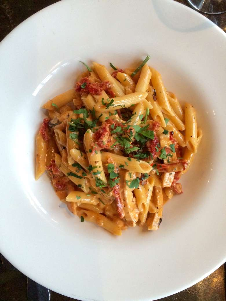 penne pasta tossed in an orange sauce