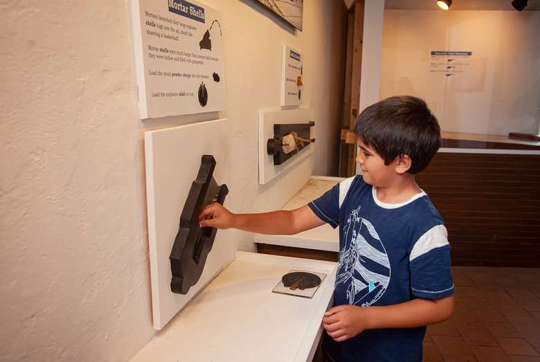 boy interacting with museum exhibit