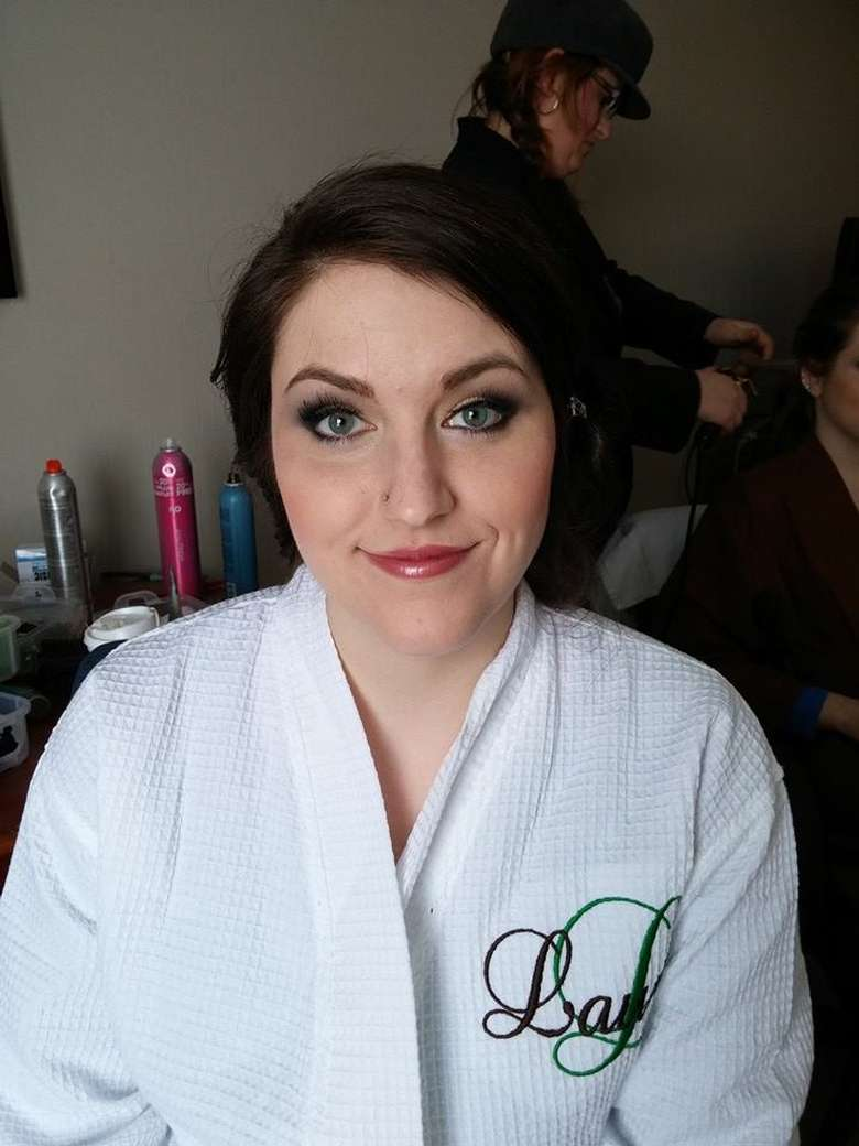 woman in robe and makeup