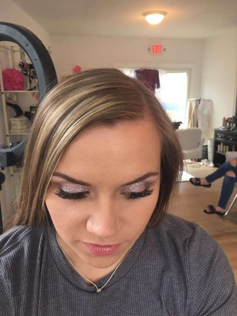 woman with makeup and false eyelashes