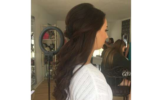 side view of woman with her hair done