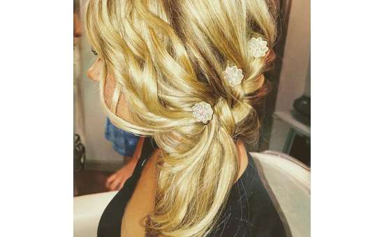 close up of braid in hair with flowers