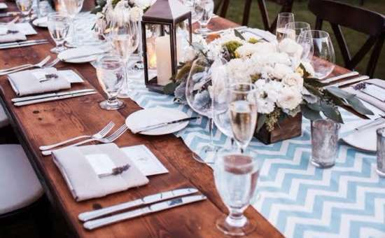 wooden table prepared for wedding reception