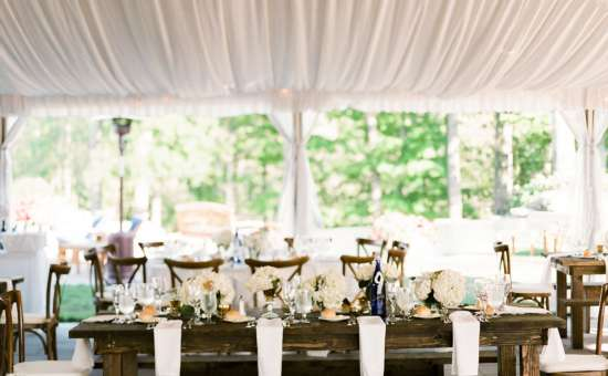 tent over wooden wedding tables