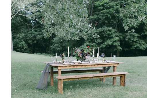 wooden table outdoors on grassy lawn