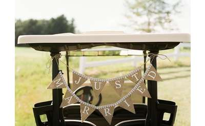 table with just married banner connected