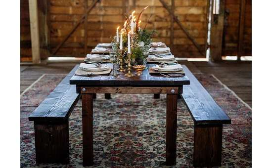 wooden table with dinnerware on top