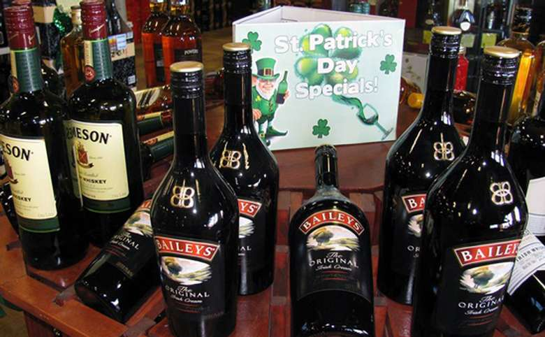 Sign on a table that says St. Patrick's day Specials with Baileys infront of it