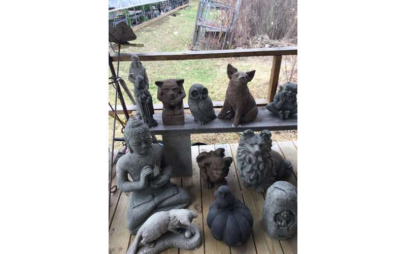 a variety of decorative garden animal statues