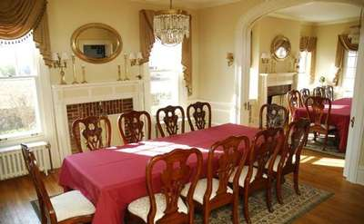 formal dining room with a table set for 10