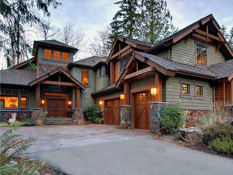 a rustic looking house with lights on outside