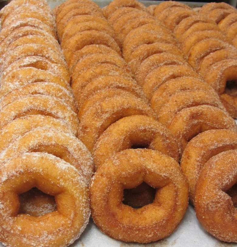 sheet tray of apple cider doughnuts