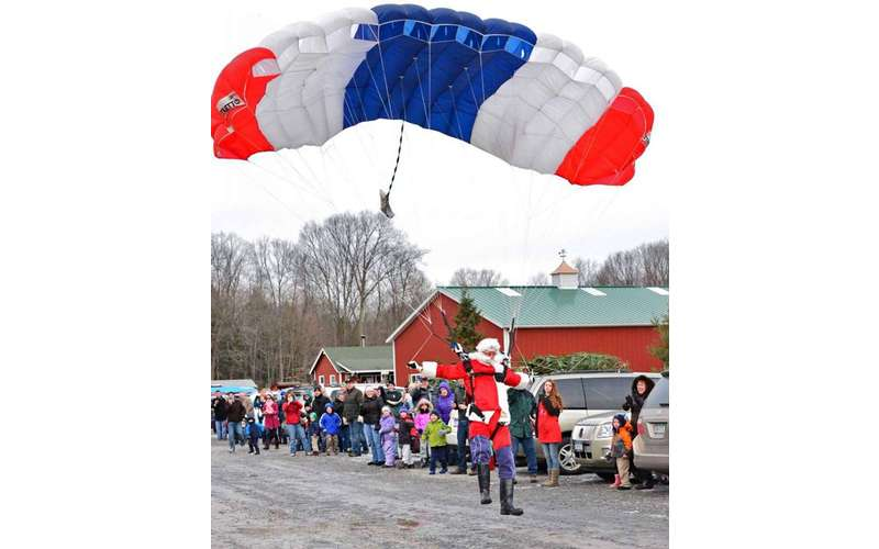 It's become tradition for Santa Claus to parachute onto Ellms Family Farm.