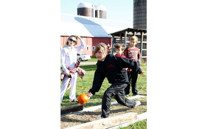Pumpkin bowling is just one of the many activities offered on the farm.