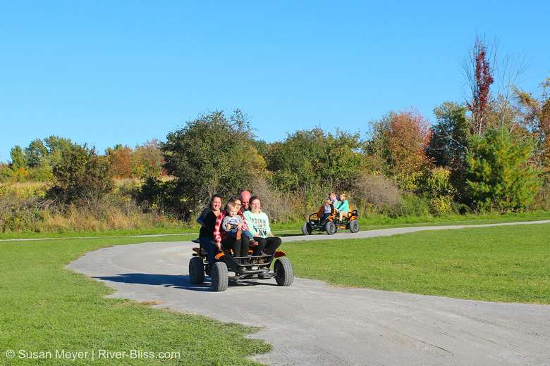 families riding on pedal carts