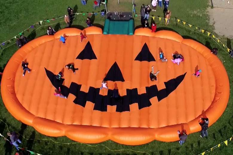aerial view of a jack-o-lantern-shaped bounce pad