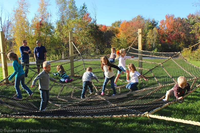 kids playing in a rope spiders web