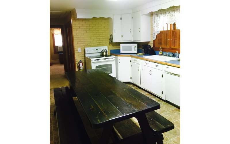 Large kitchen with great table to sit around.