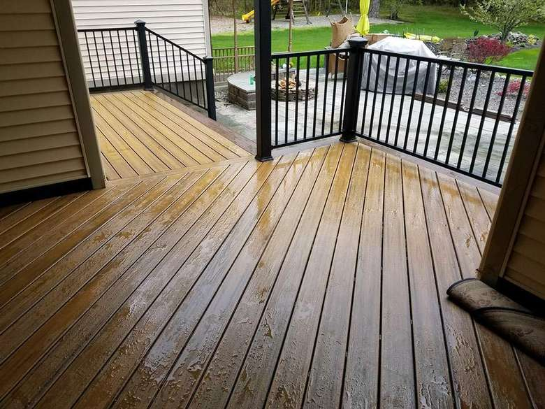 New wooden deck with metal railings