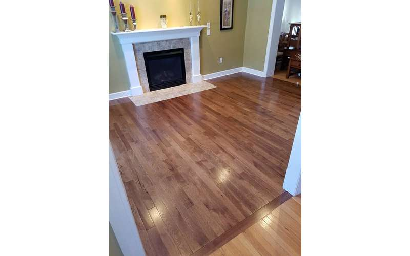 Hardwood floors are gorgeous, easy to clean, and you can always switch up the look with an attractive area rug.