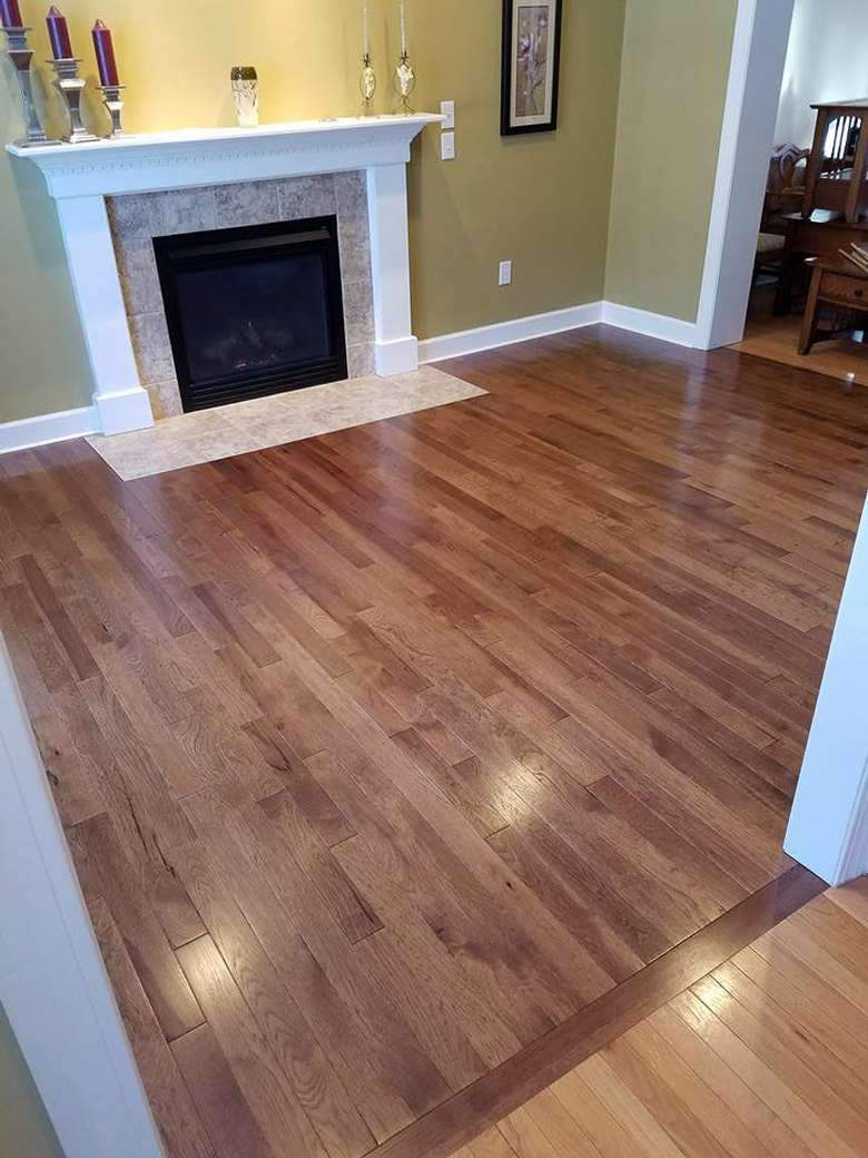 New hardwood floors in a living room with a fireplace