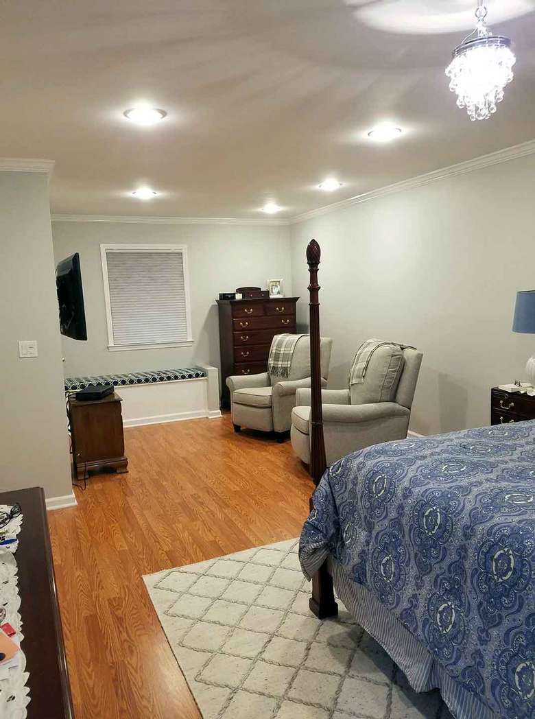 Newly remodeled master bedroom with recessed lighting and hardwood floors