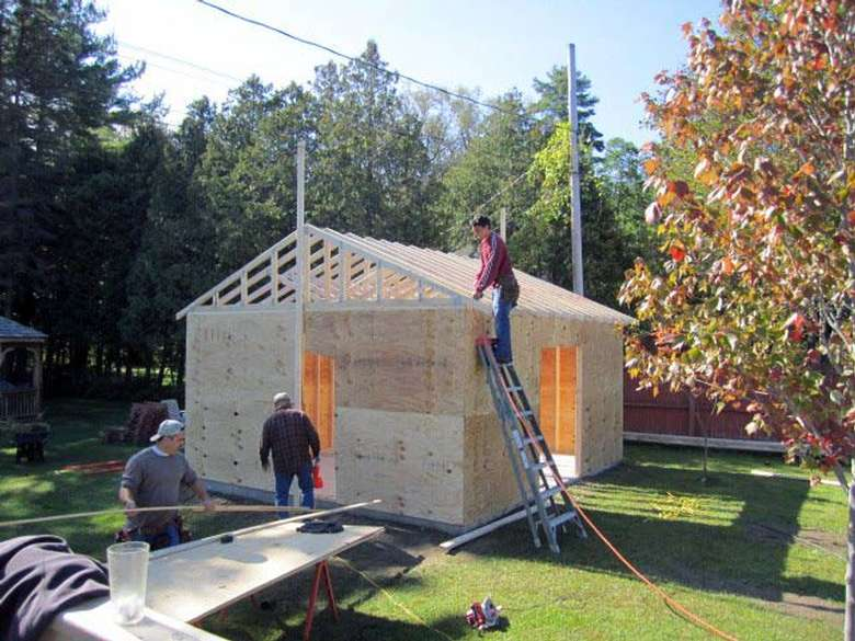 Crew building a shed in Lake George