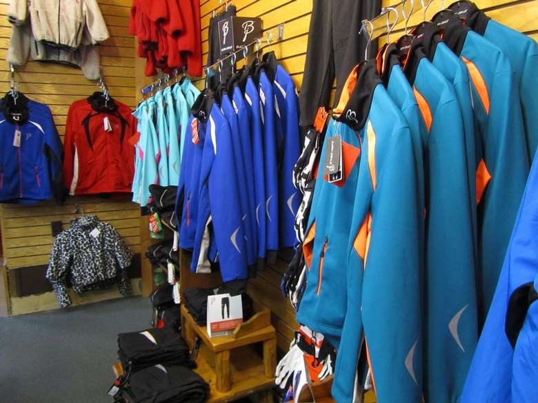 winter jackets and clothing in a ski shop