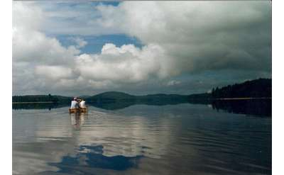 two people canoeing on lake george