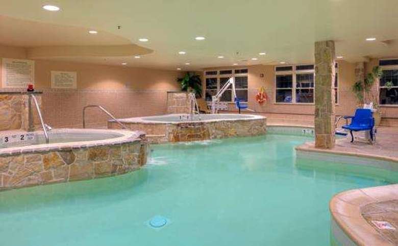 indoor pool with two whirlpool tubs
