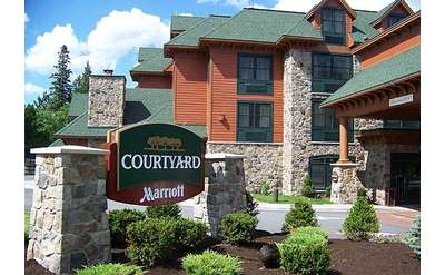 exterior of courtyard lake placid with courtyard sign