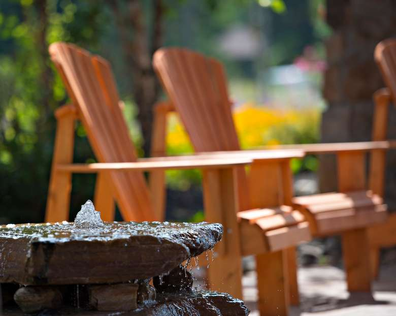 two adirondack chairs in outdoor seating area