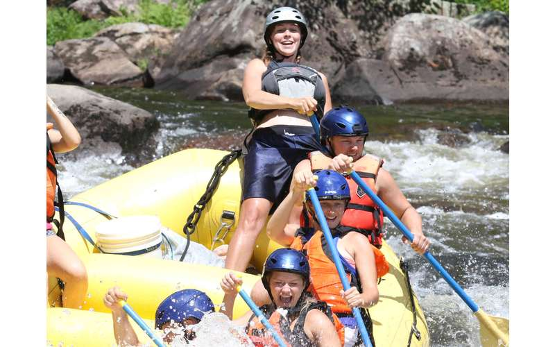 a group of rafters paddling through rapids on a river