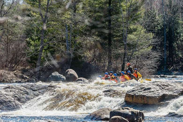 whitewater rafting over a small waterfall