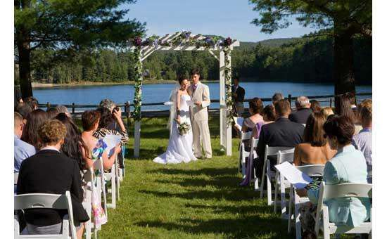 bride and groom reading something to their guests during their outdoor wedding ceremony