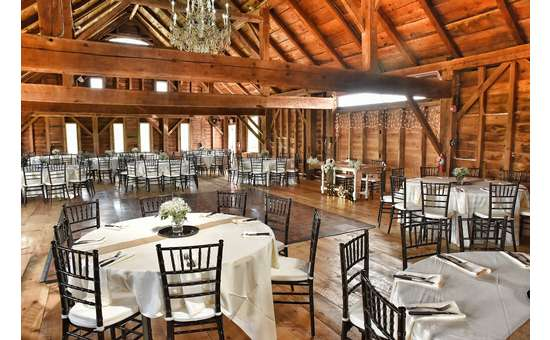 indoor shot of barn with tables set up