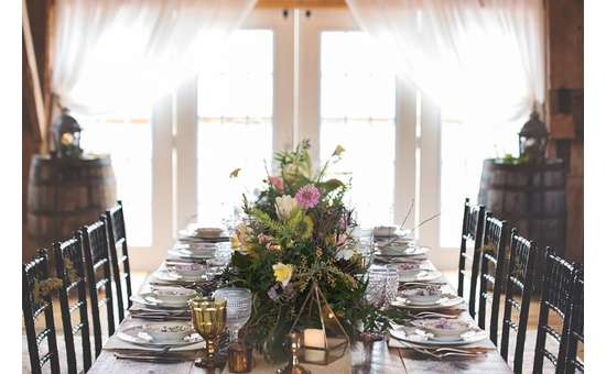 beautifully set table in front of windows