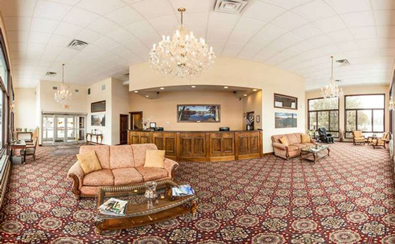 large lobby with seating areas and hotel reception desk
