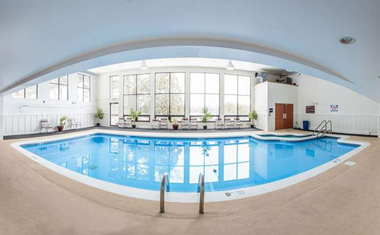 panoramic view of indoor pool surrounded by large windows