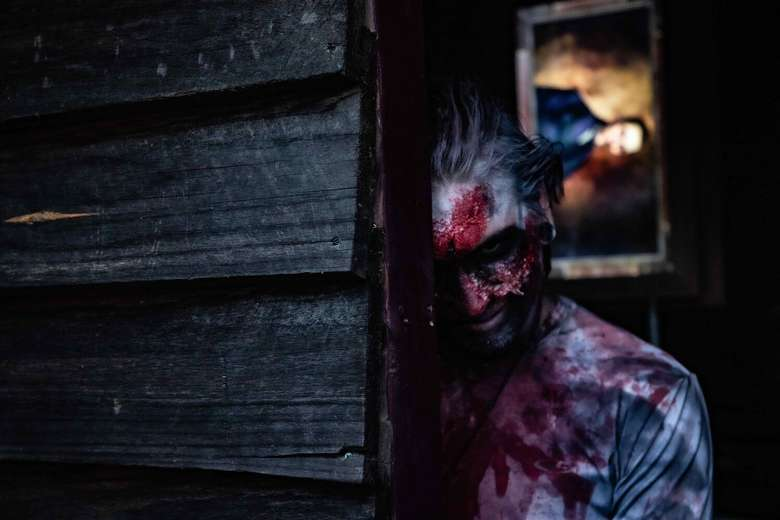 actor dressed in bloody costume