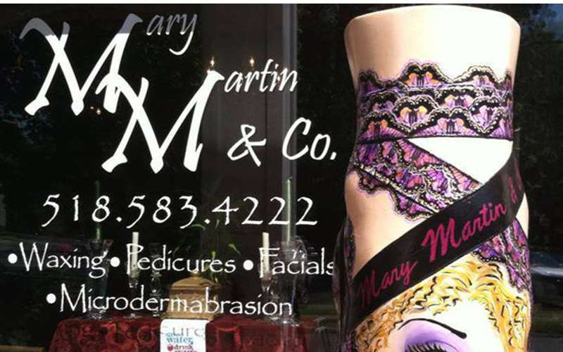 Mary Martin & Company logo with text including phone number