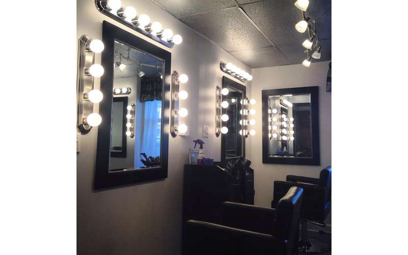 makeup chairs with mirrors and light bulbs surrounding the mirrors