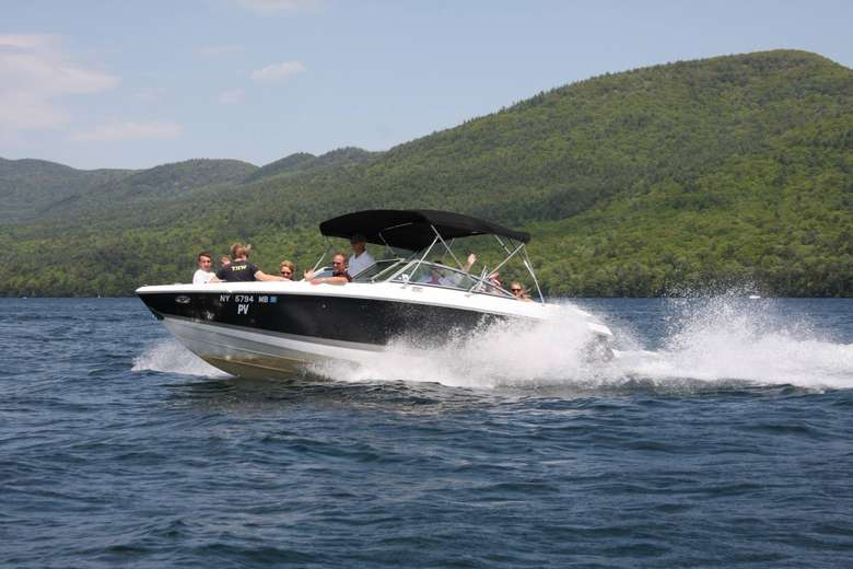 boat in motion on lake george