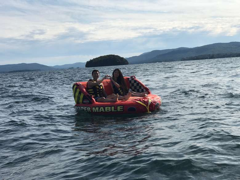 two people in a tube on lake george