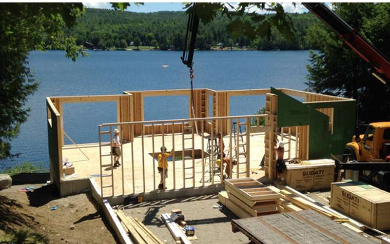 the structure of a new home being built near the waterfront