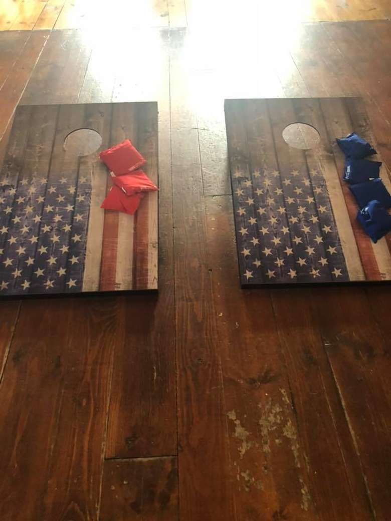 two corn hole boards decorated like american flags