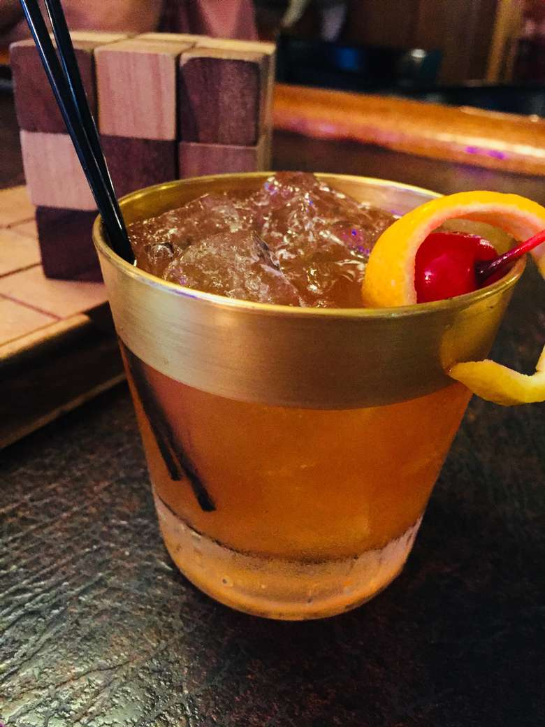 old fashioned in a glass with a golden rim