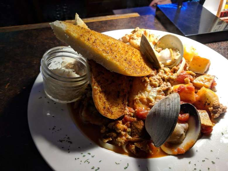 seafood stew with bread on top