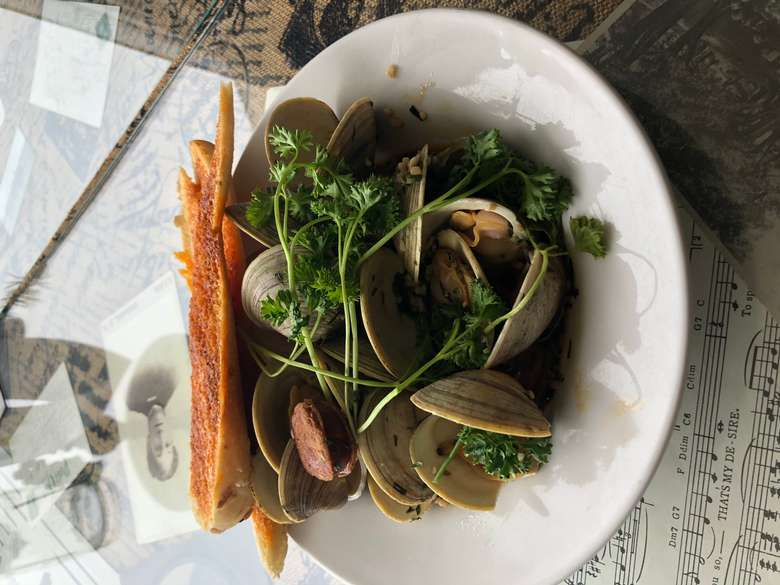 steamed clams with chorizo and greens