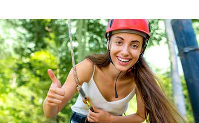 Girl on a ropes course smiling
